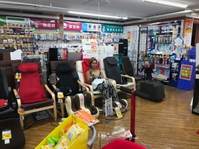 taking a break in a massage chair in an electronics store
