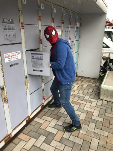 Spider-Man stashing his street clothes