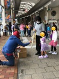 Spiderman giving candy to some princesses