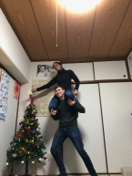 Putting the star on our little Christmas Tree