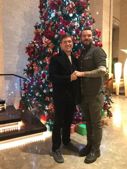 Brian and I posing with the Christmas Tree in the lobby of the Sunroute Plaza Hotel in Shinjuku